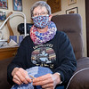 Christine Guth, of Goshen, knits a baby blanket for people who need them Thursday afternoon at her home 406 S. 7th St. in Goshen.