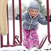 Mia Swearingen, 3, of Elkhart, climbs on the play ground equipment Wednesday afternoon at Ox Bow Park in Goshen.
