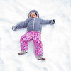 Mia Swearingen, 3, of Elkhart, makes a snow angle near the play ground equipment Wednesday afternoon at Ox Bow Park in Goshen.
