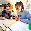 Prairieview Elementary forth grade teacher Calla Wilmmer, left, assists Sophia Chavoyo Lopez, 10, with an assignment Thursday afternoon at Prairieview Elementary in Goshen.