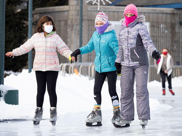 Mayli Kwitz, left, Ellie Harrison, 11, center, and Mari Harrison, 12, all of Goshen, hold hands while skating Saturday at NIBCO Water and Ice Park in Elkhart.
