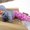 Mia Swearingen, 3, of Elkhart, slides backward down a slide Wednesday afternoon at Ox Bow Park in Goshen.