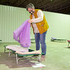 Mindy Morehead, executive director of the Goshen Interfaith Hospitality Network, prepares a cot while at the city's new emergency overnight warming shelter Wednesday morning. The shelter, which is reserved for single homeless men, opened to the public Dec. 14.