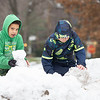 Trae Reeves, 10, left, Mason Honeycutt, 9, both of Goshen, play on a snow bank in the parking lot of Parkside Elementary Tuesday afternoon in Goshen.