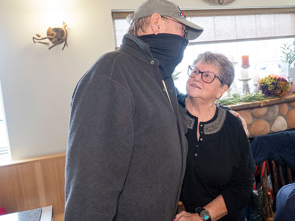 Roger Sellers, of Goshen, left, gives Dutch Maid Bakery employee Connie Kramer a hug Thursday during an open house at Dutch Maid Bakery located at 508 W. Lincoln Ave. in Goshen. Krammer is retiring after 56 years of service at Dutch Maid Bakery.