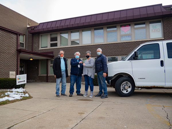 Dayton Frey, secretary-treasurer for the local Mennonite Disaster Service unit, left, joins Rollin Ulrich, chairman of the local MDS unit, second from left, in handing over the keys of a van donated by the group Thursday to Mindy Morehead, executive director of the Goshen Interfaith Hospitality Network, second from right. Also pictured is Craig Detweiler, vice chair of the GIHN board, right.