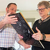 Dutch Maid Bakery President and CEO Lyle Miller, left, presents long term employee of 56 years Connie Kramer with a plaque Thursday during an open house at Dutch Maid Bakery located at 508 W. Lincoln Ave. in Goshen.