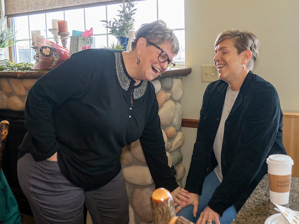 Dutch Maid Bakery employee Connie Kramer, left, and her daughter Tammy Showalter, Syracuse, spend time together Thursday during an open house at Dutch Maid Bakery located at 508 W. Lincoln Ave. in Goshen. Krammer is retiring after 56 years of service at Dutch Maid Bakery.