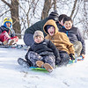 """Jayjay Ambirz, 7, left rear, Lino Rodarte, 12, left front, Karter Brigham, 13, Hector Mandujano, 12, right front, Alvaro Mandujano, 13, rear middle, and Cristian Mandujano, 11, middle right, all of Goshen, sled down the hill together Wednesday afternoon at Abshire Park in Goshen. For more photos see related photo gallery on our website  <a href=""""http://www.goshennews.com"""">http://www.goshennews.com</a>."""
