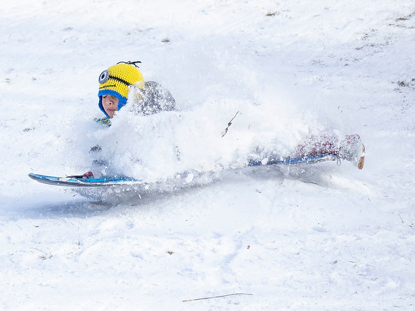 Jayjay Ambirz, 7, of Goshen, sleds down the hill Wednesday afternoon at Abshire Park in Goshen.