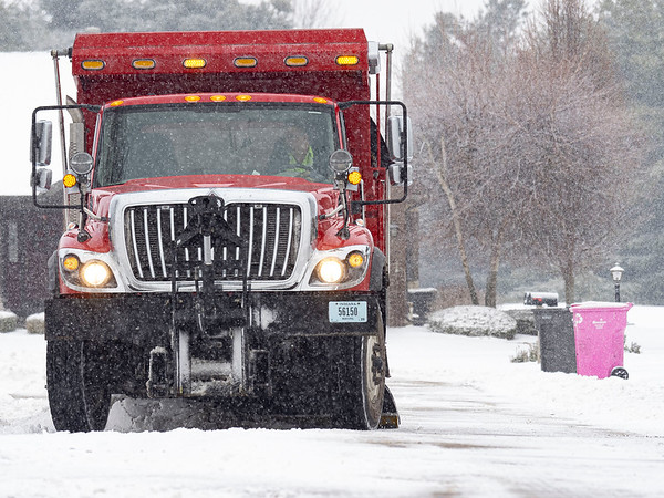 A Goshen Street Department driver plows near the intersection Coply Court and Larimer Drive  Tuesday morning inthe Larimer Village subdivision in Goshen.