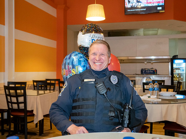 Goshen police officer Brian Knowles celebrates his retirement after 20 years of service Friday morning at the Maple Indian Cuisine in Goshen.