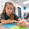 """Alex Vandamme, 8, of Nappanee adds final details to her painting Friday during the """"This Is Me"""" Quilt Mural Project at the Boys & Girls Clubs of Nappanee located at 900 E. Centennial Street."""