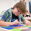 """Tytus Noyes, 13, of Dunlap, adds final details to his painting Friday during the """"This Is Me"""" Quilt Mural Project at the Boys & Girls Clubs of Nappanee located at 900 E. Centennial Street."""