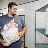 Myco Mushrooms LLC. owner Jared Bell showcases a bag of mushrooms in a room in the new Myco Mushroom Farm facility Thursday located at 722 Graywood Ave. in Elkhart.
