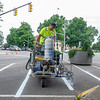 Goshen Street Department Paint and Sign Cody Currier stripes parking lanes Thursday near the intersection of South Main Street and East Lincoln Avenue in Goshen.