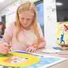 """Emma Byler, 12, of Nappanee, adds final details to her painting Friday during the """"This Is Me"""" Quilt Mural Project at the Boys & Girls Clubs of Nappanee located at 900 E. Centennial Street."""