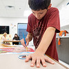 """Jamie Truex, 11, of Nappanee, adds final details to his painting Friday during the """"This Is Me"""" Quilt Mural Project at the Boys & Girls Clubs of Nappanee located at 900 E. Centennial Street."""