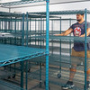 Myco Mushrooms LLC. owner Jared Bell showcases his storage racks in a room in the new Myco Mushroom Farm facility Thursday located at 722 Graywood Ave. in Elkhart.