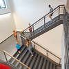 Community members walk the stairs towards the second story of Goshen Intermediate School Monday during the GIS open house located at 925 S. Greene Rd.