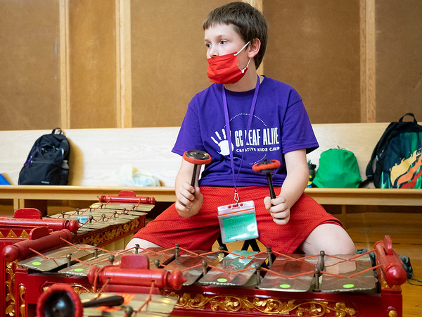 Ethan Haney plays an instrument during the Goshen College Leaf Alive: Kids Creative Camp Thursday, June 24 on the Goshen College Campus.
