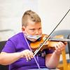 Donnie Hossler plays a violin during the Goshen College Leaf Alive: Kids Creative Camp Thursday, June 24 on the Goshen College Campus.