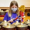 Gabrielle Bean plays an instrument during the Goshen College Leaf Alive: Kids Creative Camp Thursday, June 24 on the Goshen College Campus.
