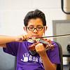 Izick Reyes, of Goshen, plays a violin during the Goshen College Leaf Alive: Kids Creative Camp Thursday, June 24 on the Goshen College Campus.