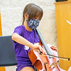 Poppy Dee Kendall, 9, of Goshen, plays a cello during the Goshen College Leaf Alive: Kids Creative Camp Thursday, June 24 on the Goshen College Campus.