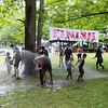 John Kline | The Goshen News<br /> Participants of Saturday's Mudtastic Classic in Syracuse get some help rising off from members of the Turkey Creek Fire Territory.