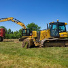 """Niblock Excavating heavy equipment operators Mark Williams, front, and Austin Macleod strip the sod for additional walking paths Tuesday at the Elkhart County 4-H Fairgrounds in Goshen. According to fair president Trent Hostetler, """"This project has been discussed for several years. We signed a new 10-year contract with North American Midway in 2019. Part of the contract involved sharing the cost of paving the midway roads. This way, the fair guests would have a paved road to walk on, instead of dirt or mud. With the canceling of the 2020 affair, we did not have funding to complete the project. The owner of North American Midway really wanted to see it done this year and so we have reworked the deal to where he is providing the financing for the project."""""""
