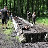 John Kline | The Goshen News<br /> Participants work their way through a particularly muddy obstacle during the seventh annual Mudtastic Classic in Syracuse Saturday morning.