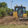 """Niblock Excavating heavy equipment operator Mark Williams strips the sod for additional walking paths Tuesday at the Elkhart County 4-H Fairgrounds in Goshen. According to fair president Trent Hostetler, """"This project has been discussed for several years. We signed a new 10-year contract with North American Midway in 2019. Part of the contract involved sharing the cost of paving the midway roads. This way, the fair guests would have a paved road to walk on, instead of dirt or mud. With the canceling of the 2020 affair, we did not have funding to complete the project. The owner of North American Midway really wanted to see it done this year and so we have reworked the deal to where he is providing the financing for the project."""""""