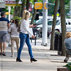 Boys and Girls Clubs of Elkhart County Goshen Unit Club Experience Manager Natalie Jerlecki, center, walks towards Woldruff's Footwear & Apparel from Jules Boutique Tuesday afternoon in Goshen.