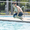 Blake Griffith, 9, of Nappanee, performs a canonball into the Nappanee Public Pool Friday afternoon. The pool is located in Stauffer Park at 754 Stauffer Drive.