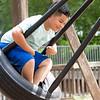 Damian Sanabrina, 6, of Goshen, swings on the tire swing Wednesday at Shanklin Park in Goshen.