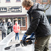 Ice Carver Patrick Hunsley, of Michigan City, carves an angle fish in front of spectators Saturday during the Downtown Goshen Fire and Ice Festival along Main Street in Goshen.