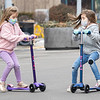 Lydia Jordan, 5, left, and her sister Violet Jordan, 7, both of Goshen, ride their scooters Saturday during the Downtown Goshen Fire and Ice Festival along Main Street in Goshen.