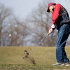 Wes Young, of Syracuse, left, chips out of the rough Wednesday afternoon at Wawasee Golf Club in Syracuse.