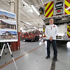 Middlebury Fire Department Fire Chief Jeff Wogoman stands near a rendering of what the completed renovation of the Middlebury Fire Station and Town Hall will look like Tuesday during the ground breaking ceremony at the Middlebury Fire Station in Middlebury.