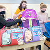 Benton Elementary Student Council members Allie Stahly, 11, left, of Goshen, Lacy Stoltzfus, 12, of Goshen, and Lorelei Shively, 12, of New Pairs, pack backpacks with food for students in need Tuesday afternoon at Benton Elementary. In total the students raised $6,000.00 with their pretzel sales and provided hundreds of pounds go for through their food drive. The money and food donations will go to the Blessings in a backpack program that provides easy to prepare meals for students on the weekends when school meals are not available to Fairfield Elementary Schools students.
