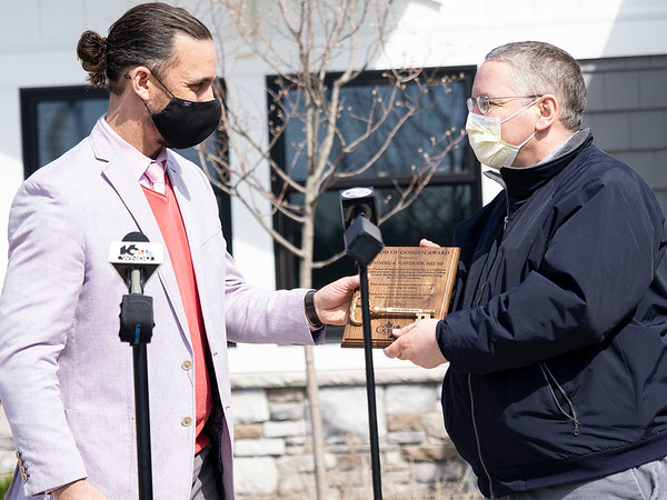 "Goshen Mayor Jeremy Stutsman, left, presents Goshen Health Hospital Chief Medical Officer Daniel Nafziger with ""Good of Goshen"" award Monday at the Goshen Health Foundation located at 1701 South Main Street, in Goshen."