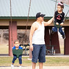 Nelson Lopez, center,  pushes Lineth Lopez, 6, right, and Dylan Lopez, 3, all of Goshen, on the swings Tuesday afternoon at Rogers Park in Goshen.
