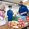 Benton Elementary Student Council members Kiara Jaberg, 12, of Millersburg, Gavin McGowen, 12, of New Paris, and Smith Wogoman, 12, of Goshen, pack food for students in need Tuesday afternoon at Benton Elementary. In total the students raised $6,000.00 with their pretzel sales and provided hundreds of pounds go for through their food drive. The money and food donations will go to the Blessings in a backpack program that provides easy to prepare meals for students on the weekends when school meals are not available to Fairfield Elementary Schools students.