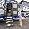 Tom Alexander, business manager at International RV LLC in Elkhart, showcases a Riverstone Legacy Fifth Wheel RV during a visit to the dealership Thursday afternoon.