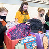 Benton Elementary Student Council members Allie Stahly, 11, left, of Goshen, Lacy Stoltzfus, 12, of Goshen, Lorelei Shively, 12, of New Pairs, and Maddie Leatherman, 12, of Goshen, pack backpacks with food for students in need Tuesday afternoon at Benton Elementary. In total the students raised $6,000.00 with their pretzel sales and provided hundreds of pounds go for through their food drive. The money and food donations will go to the Blessings in a backpack program that provides easy to prepare meals for students on the weekends when school meals are not available to Fairfield Elementary Schools students.