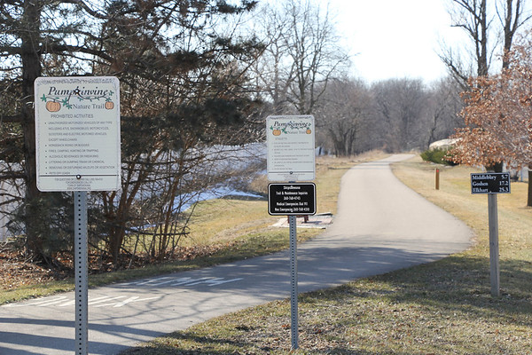 Signs mark the current trailhead of the Pumpkinvine Nature Trail along North 850 West in Shipshewana. The state awarded Shipshewana a $953,482 grant through the Next Level Trails program to extend the Pumpkinvine east through the heart of town.