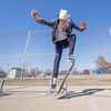 Goshen College student Caleb Gingerich, of Kalona, Iowa, performs an ollie at Tyler S. Joldersma Memorial Skatepark Friday in Goshen.