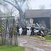Concord Township firefighters work at the scene of a garage fire, 22526 C.R. 18, Monday.
