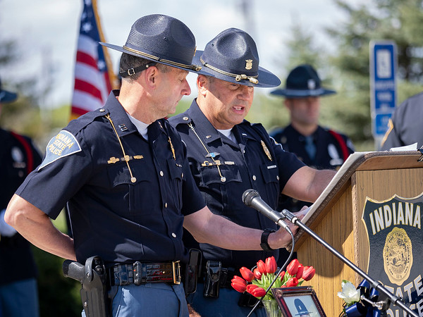 Indiana State Police captain Kevin Smith, left, and Lt. Mike Young read the names of all the Indiana State Police officers who gave the ultimate sacrifice in the line of duty during the memorial service Wednesday at Indiana State Police Toll Road District Post 21 located at 52422 County Rd 17 in Bristol.